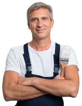 A picture of a painting contractor from Fremont, Ca wearing overalls and holding a paint brush.