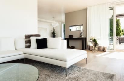 A picture of a house interior that is white and grey with a white couch after home painting in Fremont Ca